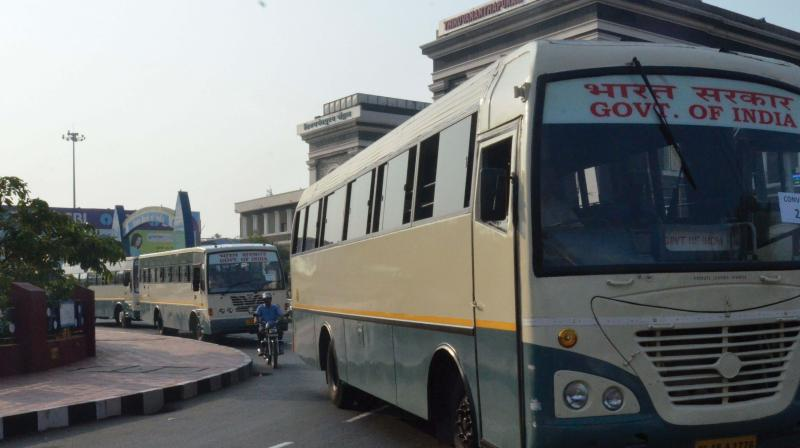 A convoy of VSSC buses go past the Thiruvananthapuram Central Railway station on the general strike day on  Monday. (Photo: Peethambaran Payyeri)
