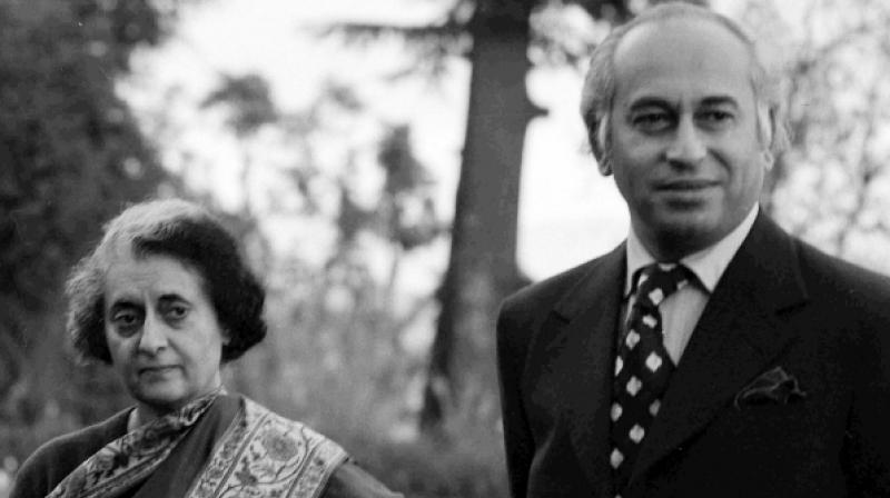 Pakistani leader Zulfikar Ali Bhutto stands with Indian Prime Minister Indira Gandhi before a summit in Simla, India, on June 28, 1972. Bhutto was overthrown in a military coup in 1977 and hanged two years later (Photo: Associated Press)