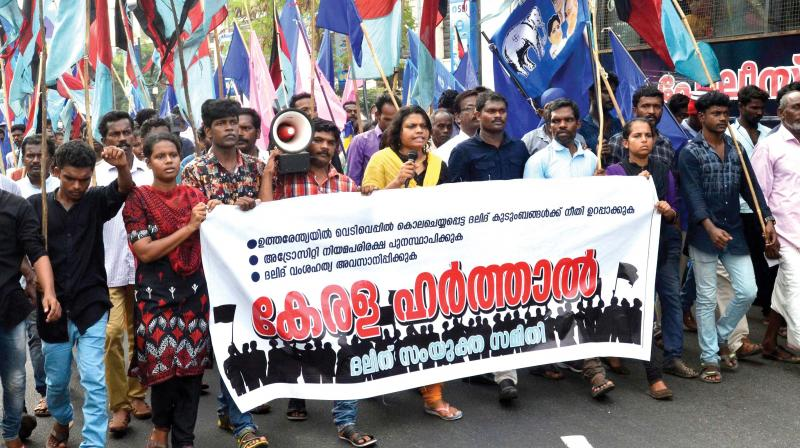 Dalit activists take out a march from Thampanoor in Thiruvanthapuram on Monday.