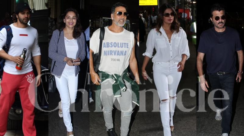 Bollywood stars Akshay Kumar, Priyanka Chopra, Anil Kapoor, Madhuri Dixit-Nene, Varun Dhawan and others were spotted in the city. Checkout the latest pictures of your favourite Bollywood celebrities right here. (Photos: Viral Bhayani)