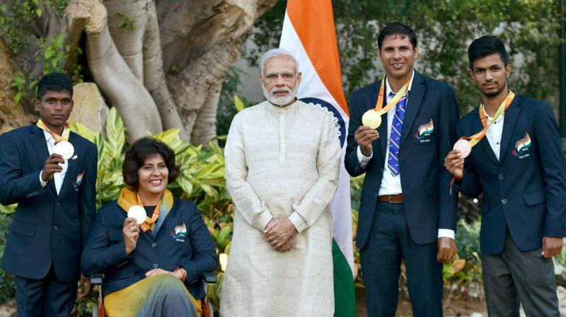 PM Narendra Modi with the Rio Paralympics medallists. (Photo: PTI)