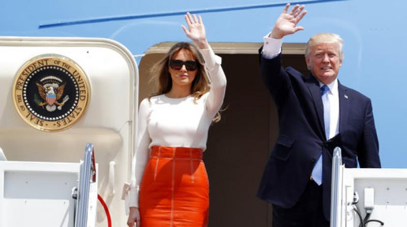 Donald Trump, Melania Trump  President Donald Trump and first lady Melania Trump, wave as they board Air Force One at Andrews Air Force Base, prior to his departure on his first overseas trip. (Photo: AP)