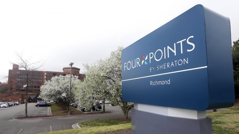 This March 25, 2016, file photo shows the sign at the Four Points Sheraton Hotel in Richmond, Va. The information of as many as 500 million guests at Starwood hotels has been compromised and Marriott said that it's discovered that unauthorized access to data within its Starwood network has been taking place since 2014. The company said Friday, Nov. 30, 2018, that credit card numbers and expiration dates of some guests may have been taken. (AP Photo/Steve Helber, File)