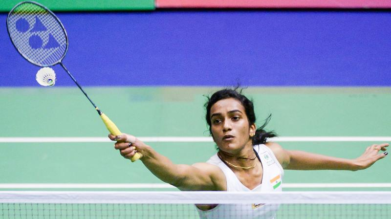 The 22-year-old Indian shuttler outplayed Jindapol 21-13, 13-21, 21-18 in the second round of the women's singles event. (Photo: AFP)