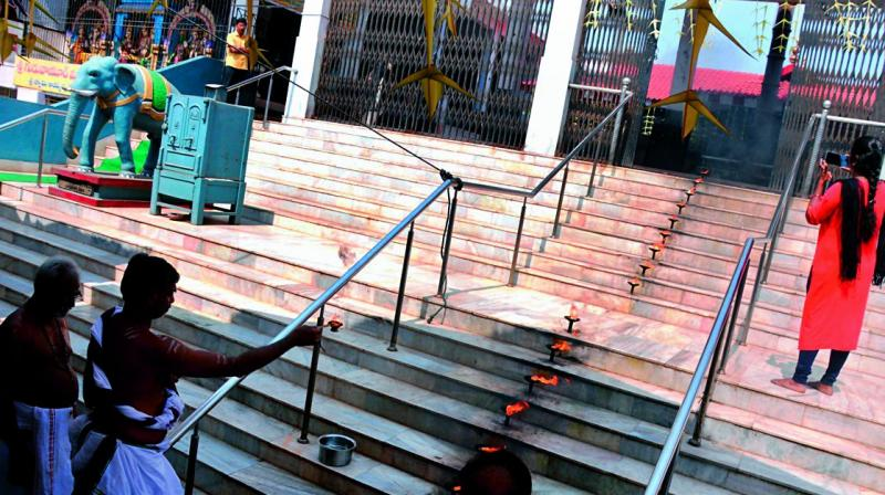 Chief priest of the Ayyappa Swamy temple performs rituals to begin  construction of 18 holy steps on the premises on Monday.