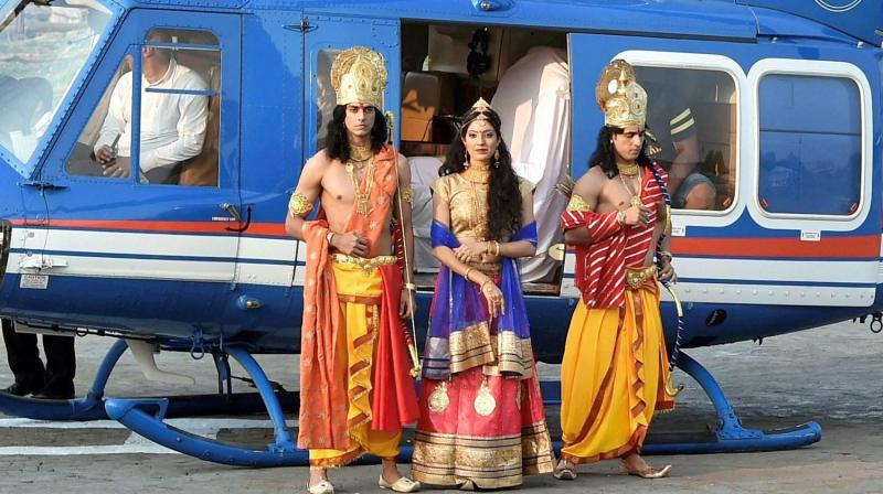 Artistes dressed up as Lord Rama, Sita and Lakshman arrive by a chopper for Deepotsav celebrations in Ayodhya on Wednesday (Photo: PTI)