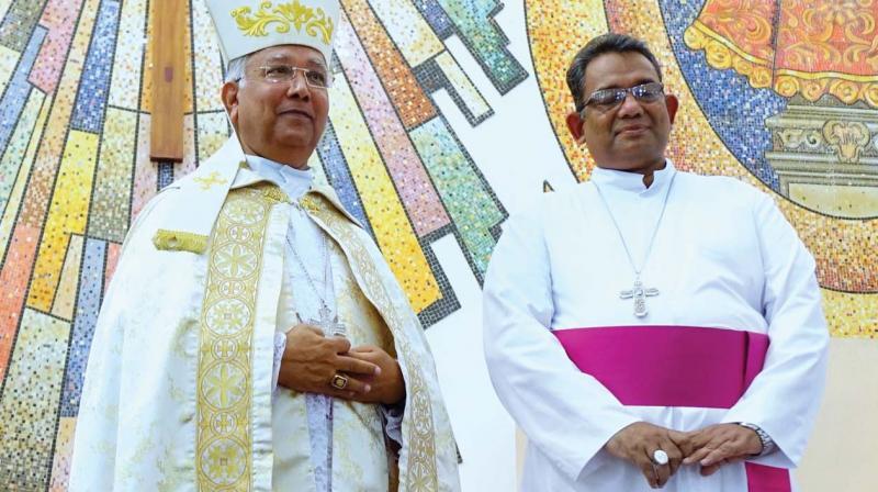 Bishop elect Paul Antony Mullassery with former Bishop Stanley Roman.