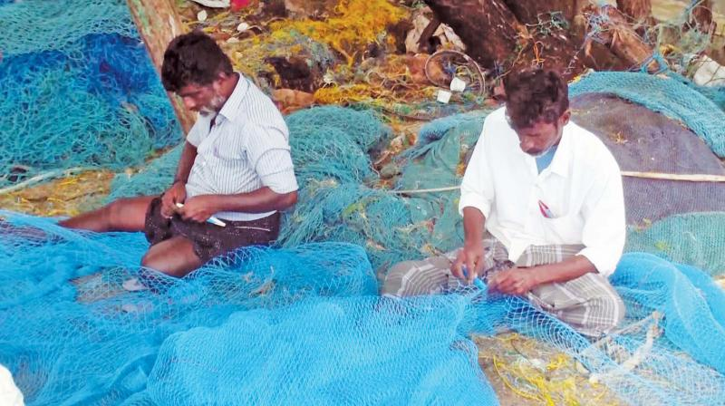 Fishermen in Rameswaram repair their nets .	(Photo: DC)