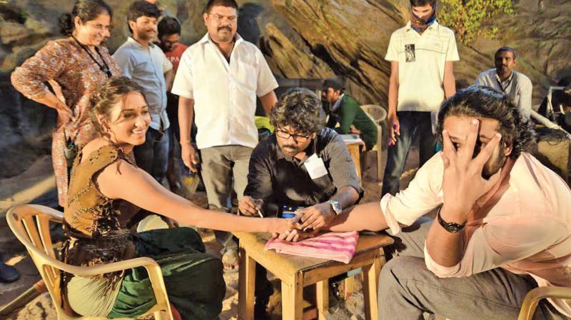 Viswanath working with Tamannaah and Prabhas.