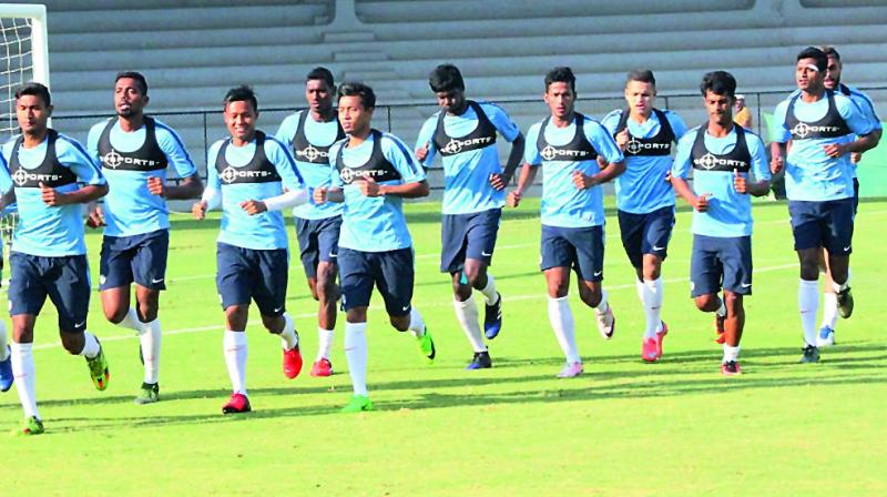 Members of the India team at a practice session in Phnom Penh, Cambodia, on Tuesday, the eve of their friendly against the hosts.