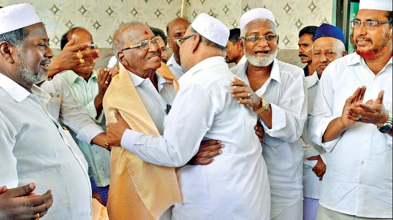 AIADMK rebel candidate E. Madhusudhanan campaigns at a mosque in Netaji Nagar on Tuesday. (Photo: DC)