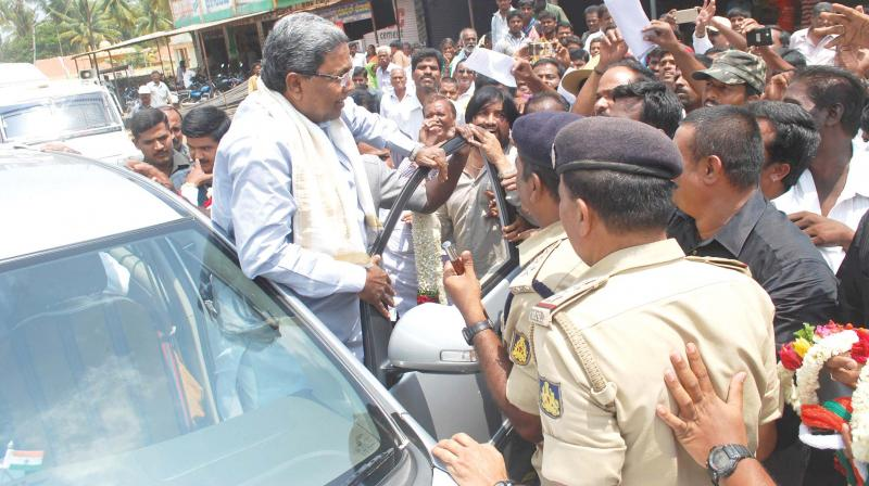 Image result for latest images of former CM Siddaramaiah's escort police officer