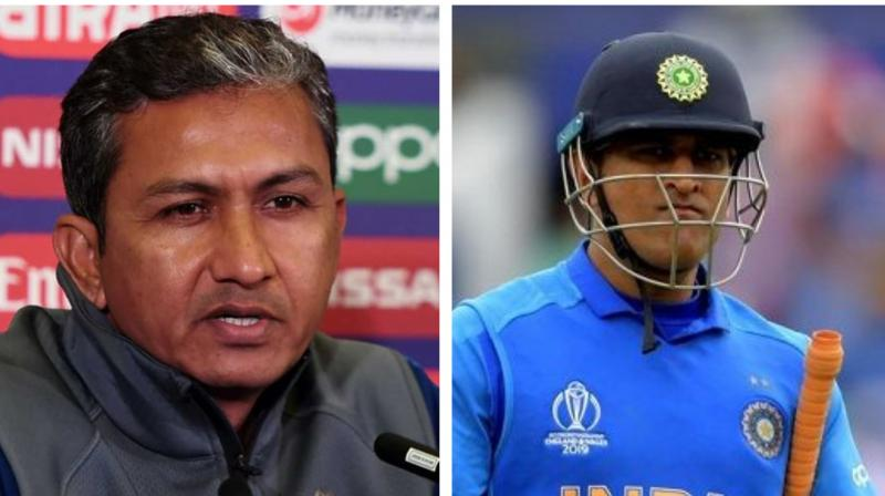 Former Indian cricket team's batting coach Sanjay Bangar, whose contract recently came to an end after the West Indies tour, has recently stated that during the whole 2019 World Cup campaign all decision were taken by the team management, including the decision to send Mahendra Singh Dhoni at number 7 during India's high tension World Cup semi-final match against New Zealand. (Photo:AFP)