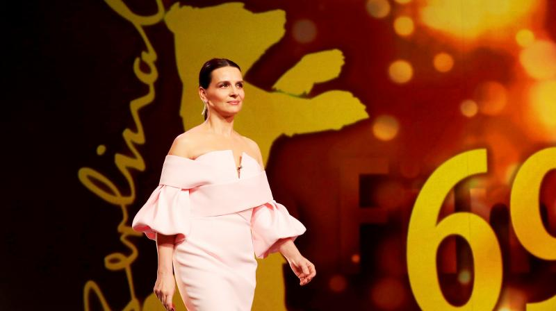 Actress and jury president Juliette Binoche walks onstage at the award ceremony of the 2019 Berlinale Film Festival in Berlin. (Photo: AP)