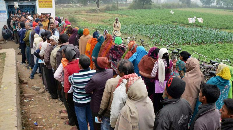 FIle photo of villagers queuing up in front of a bank branch to withdraw cash in Mirzapur recently. (Photo: PTI)