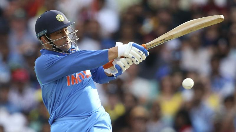 This was Dhoni's third ODI fifty in as many games on the current tour Down Under, and his 70th overall in the 50-over format. (Photo: AFP)