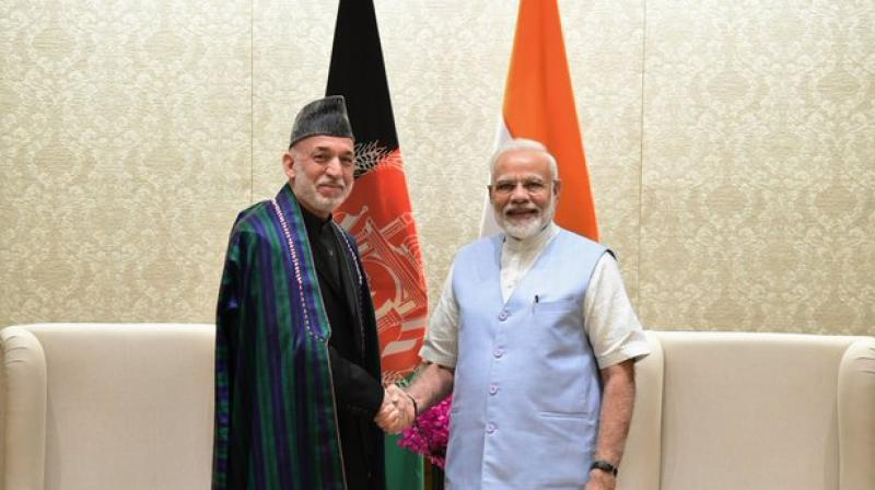 PM Narendra Modi with former President of Afghanistan Hamid Karzai. (Photo: ANI)