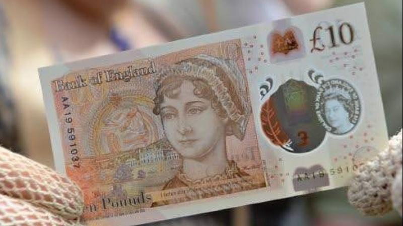 One of the new ten pound notes, featuring author Jane Austen, duting its launch at Winchester Cathedral in Winchester, southern England. (Photo: AFP)