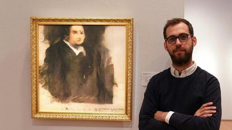 The signature on the painting is an algorithm that was actually used to create the artwork (Photo: AFP)