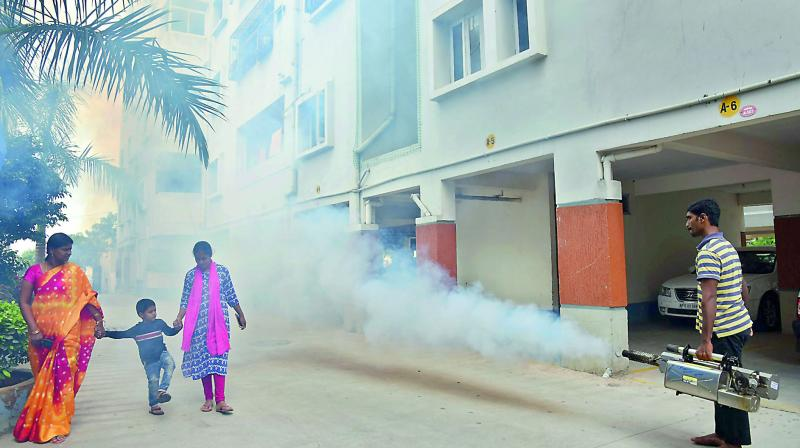 Mosquito fogger is being used to control viral fevers at Sanjana Malathi apartments in Uppal. (Photo: Gandhi)