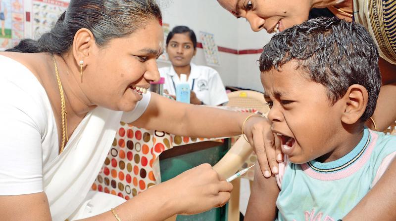 A child gets Measles Rubella vaccination at Ashok Nagar.