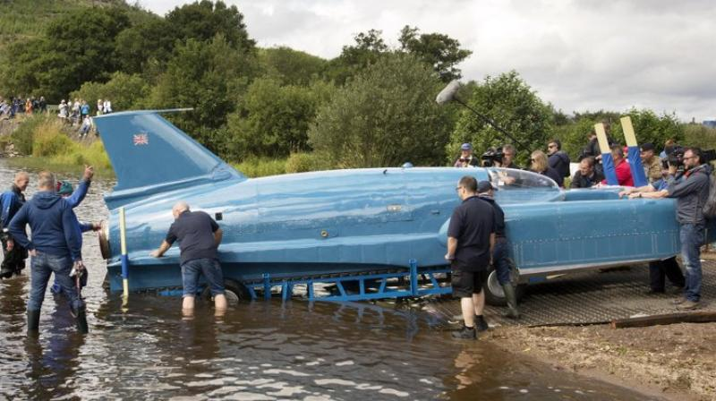 The jet-powered Bluebird roared past 300 mph (482 kph) before it vaulted into the air, flipped and crashed into the lake, breaking in two and killing the 45-year-old Campbell. (Photo: AP)