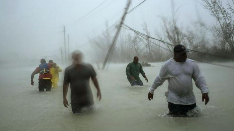 Chaotic conditions around the islands were interfering with flights and boats, hampering relief efforts. (Photo: AP)