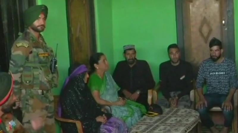 Defence Minister Nirmala Sitharaman went to the remote hamlet of Salani border to express her condolences to the family of Aurangzeb. (Photo: Twitter/ANI)