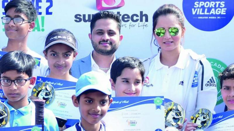 Sania Mirza (right) at a promotional event in Greater Noida on Sunday.