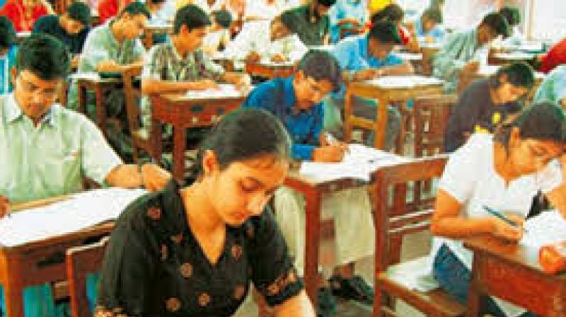 There will be a three-hour exam which includes three sections - physics, chemistry and biology.  (Representational Images)