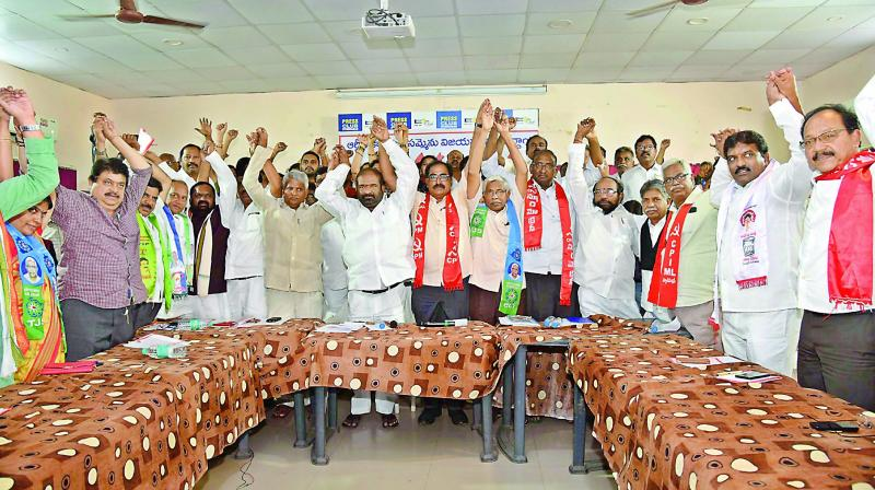 Leaders of different political parties and social organisations raise hands to express solidarity with TSRTC employees, who were on strike from October 5, in Hyderabad on Wednesday. (Photo: DC)