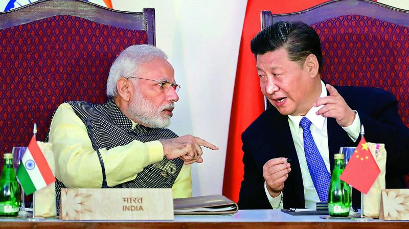(File photo) Prime Minister Narendra Modi talks with Chinese President Xi Jinping during Brics summit in Goa.