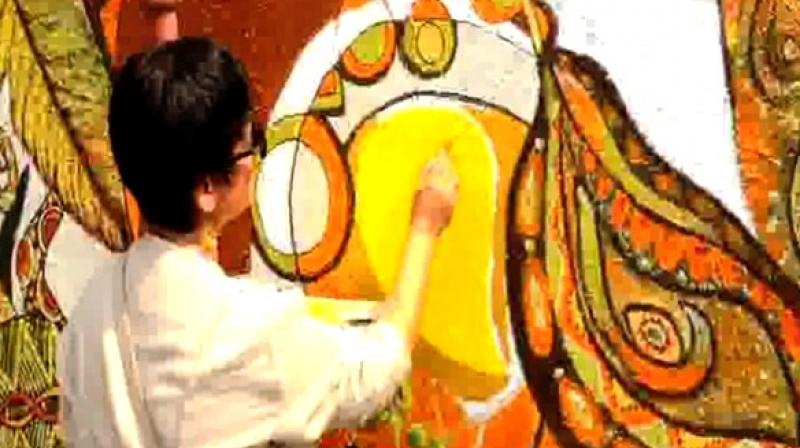 The artists from all over the world are together painting a mural at the central bus stand in Vadodara. (Photo: ANI)