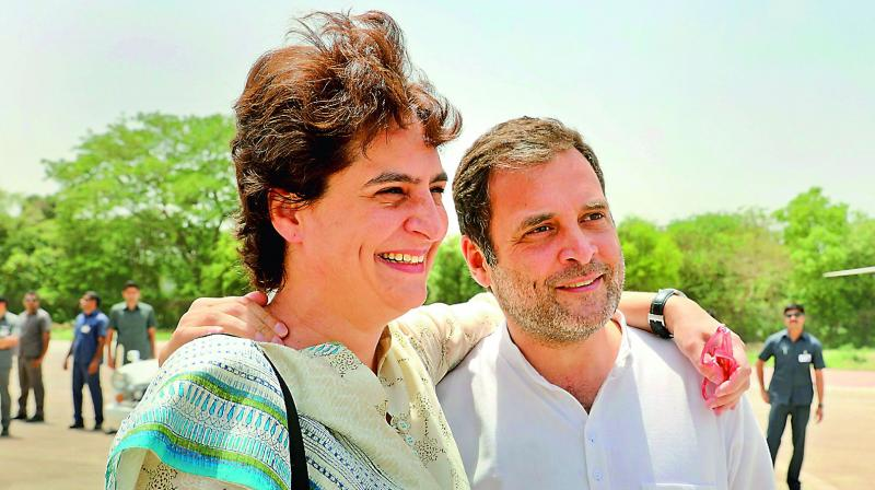 Congress president Rahul Gandhi with party's general secretary and sister Priyanka Gandhi Vadra in Rae Bareli on Saturday. 	 (PTI)
