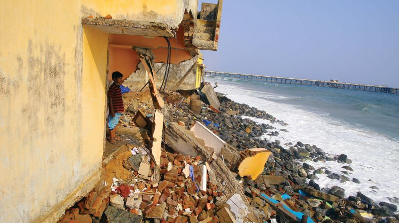 Houses destroyed as sea swelled at Valiyathura in Thiruvananthapuram.  (DECCAN CHRONICLE)