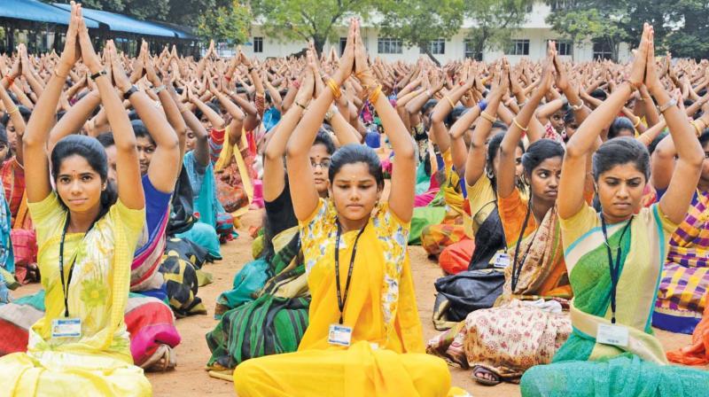 Students of Valliammal  college for women, Anna Nagar, perform yoga to mark Internationl yoga day. (Photo: DC)