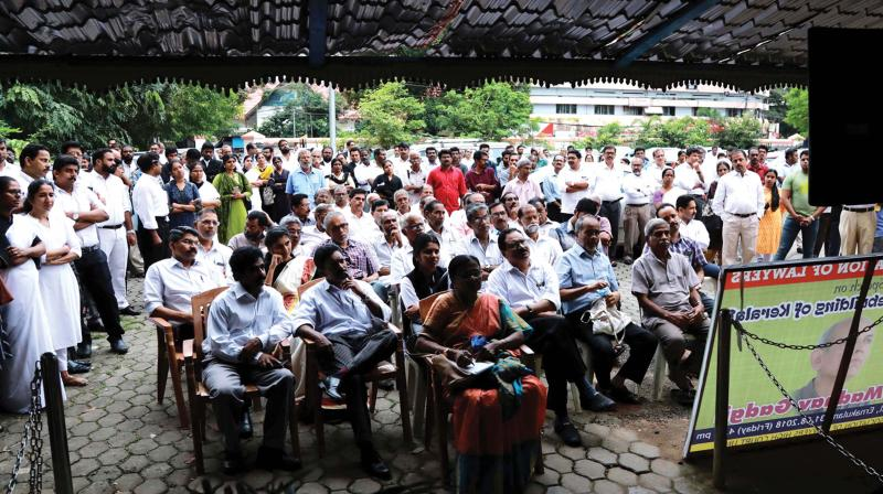 A large number of people turned out to listen to Madhav Gadgil's talk. People failed to get places inside the hall seen listening to the speech from outside through television projection. (Photo:DC)