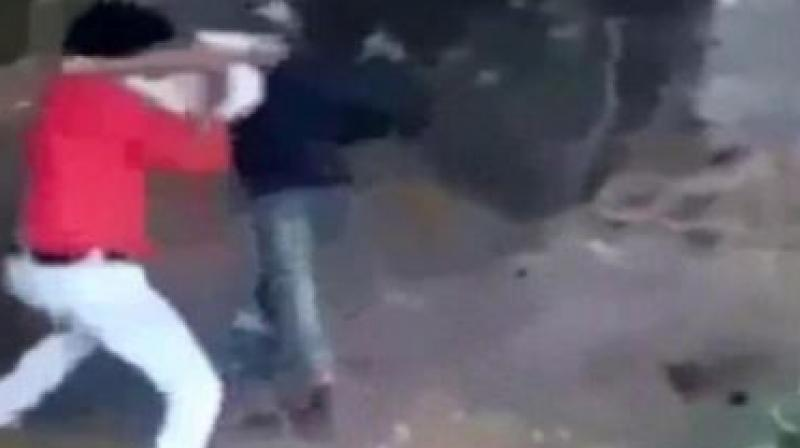 The video showed a man leading the victim identified as Mohammed Afrazul, to a spot and then attacking him with an axe from behind. (Screengrab from NDTV)