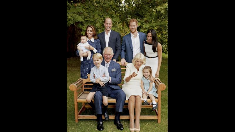 In this handout image provided by Clarence House and taken on Sept. 5, 2018, Britain's Prince Charles poses for an official portrait to mark his 70th Birthday in the gardens of Clarence House, with Camilla, Duchess of Cornwall, Prince William, Kate, Duchess of Cambridge, Prince George, Princess Charlotte, Prince Louis, Prince Harry and Meghan, Duchess of Sussex, in London, England. (Photo: Twitter/Kensington Palace)