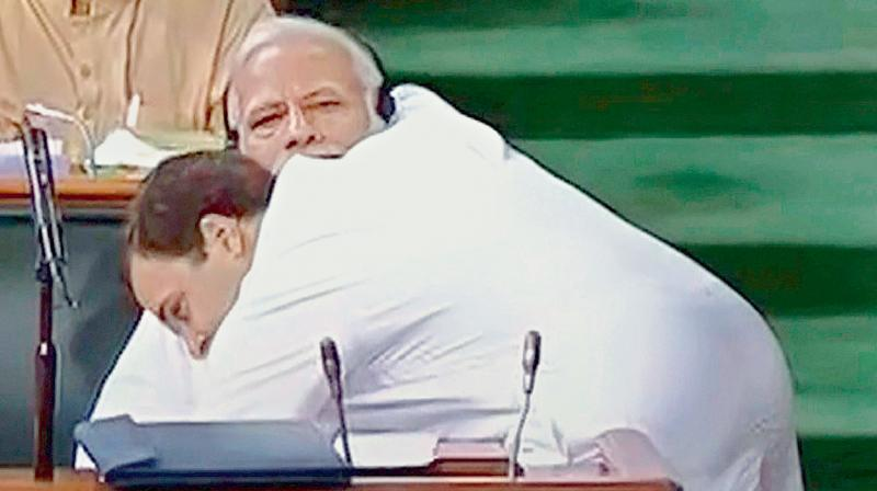on the house: Congress president Rahul Gandhi was mocked by Prime Minister Narendra Modi for asking him to stand for a hug. Mr Modi said the Congress leader was in a hurry to unseat him.