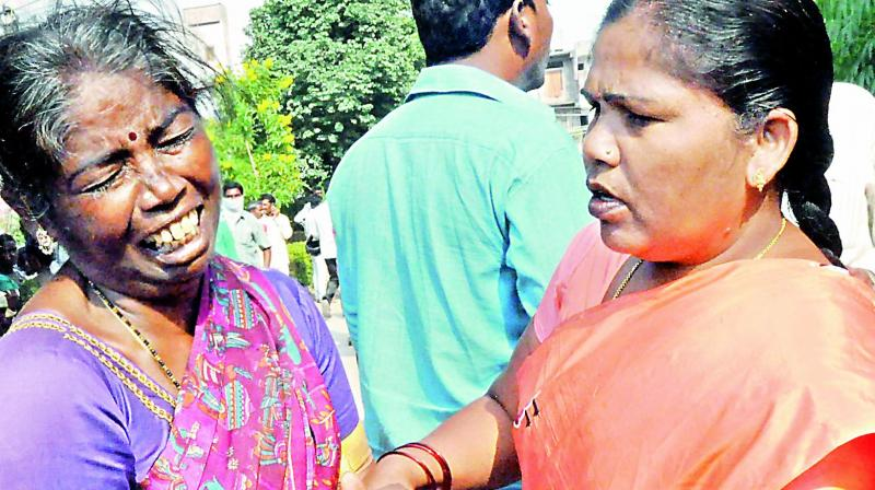 A woman tries to console a family member of one a person who died in the bus crash in Jagtial.(Photo: DC)