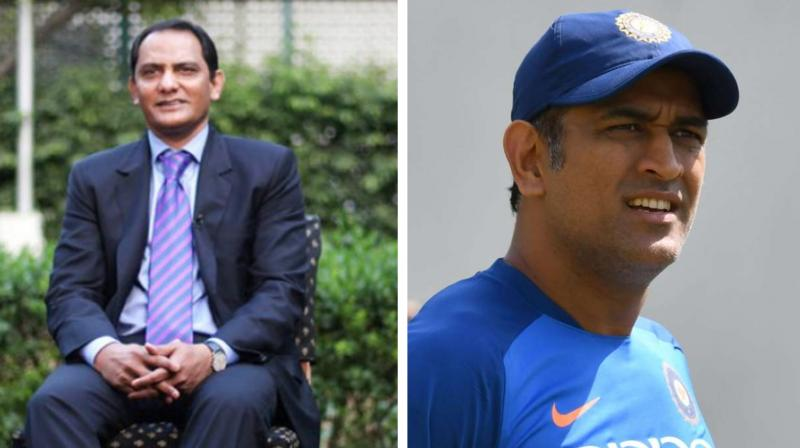 Mohd Azharuddin and MS Dhoni (Photo: AFP)