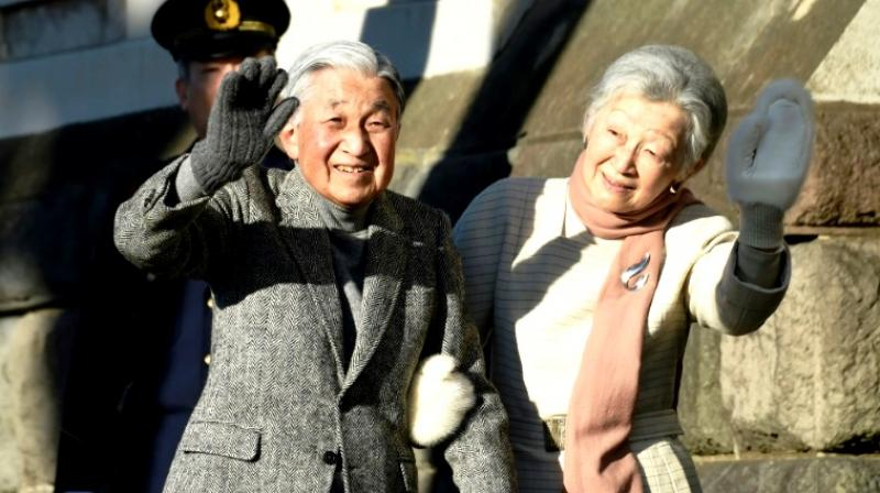 Japanese Emperor Akihito and Empress Michiko leaving the stage as he stepped down on April 30, the latest in a string of historic abdications. (Photo: AFP)