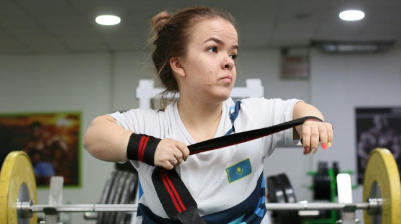 In a gym in Kazakhstan's largest city Almaty, Paralympic weightlifter Alina Solodukhina's slight shoulders are feeling the strain under more than 60 kilogrammes of cast iron. (Photo: AFP)