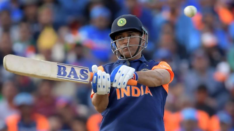 MS Dhoni plays a shot wearing India's new orange jersey in a league stage match against England at the ICC Cricket World Cup 2019. (Photo: AFP)