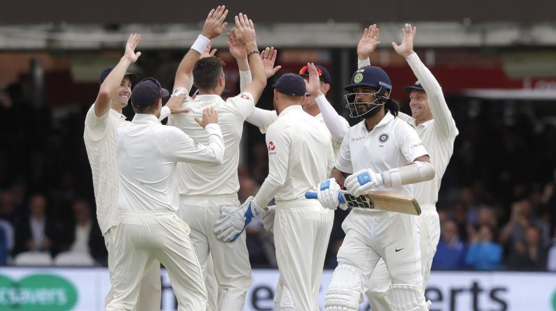 England players celebrate the dismissal of Murali Vijay, after the Indian was dismissed in the first over. (Photo: AP)