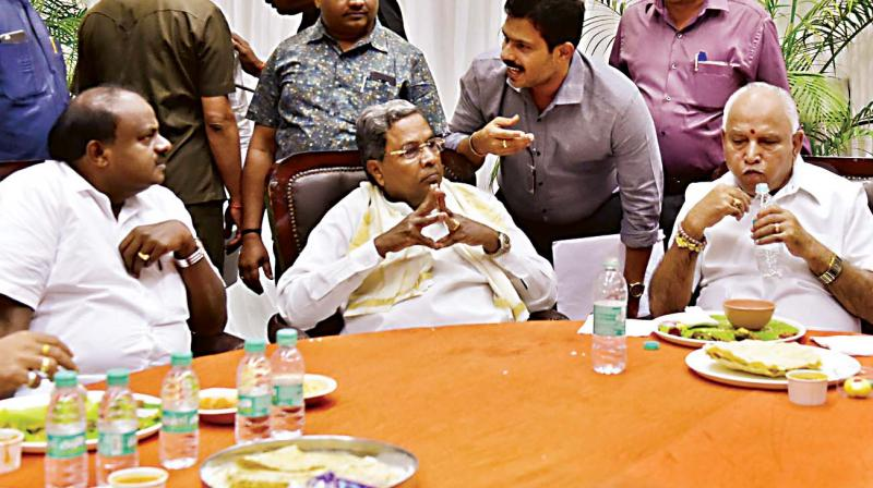 Chief Minister H.D. Kumaraswamy (from L) having lunch with former CM Siddaramaiah and BJP state chief B.S. Yeddyurappa in Vidhana Soudha on Thursday.