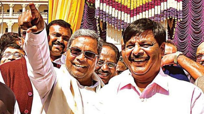 A file picture of former minister H.C. Mahadevappa with  former chief minister Siddaramaiah.