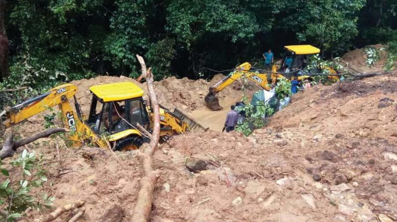 Landslide on NH 75 at Charmadi Ghat on Tuesday left hundreds of vehicles stranded on either side of the ghat 	—DC
