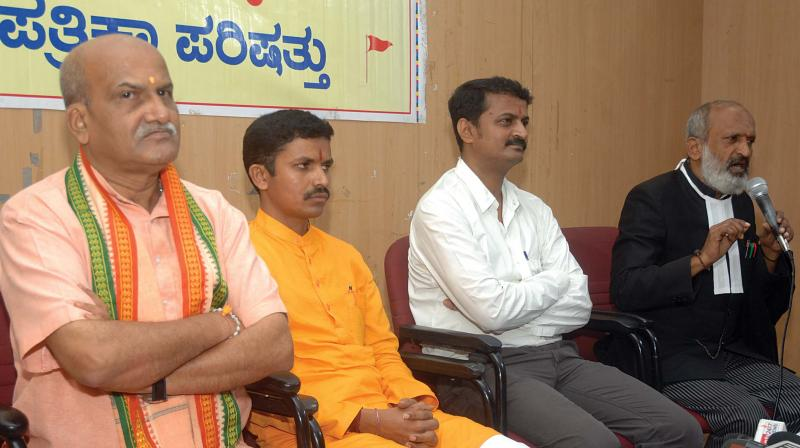 Sri Rama Sene President Pramod Muthalik, Hindu Janajagruti Samiti President Mohan Gowda, advocates Virendra Ichalkaranjikar and Amruthesh address the media at Press Club of Bengaluru on Tuesday